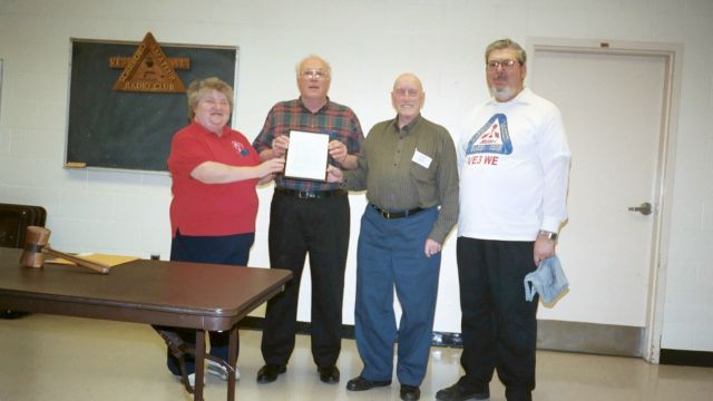 Audrey Little VA3YD, Gord Hogarth VE3CNA, Leo Kelly VE3HUN, Bob Chrysler VE3IEL with copy of cease fire order