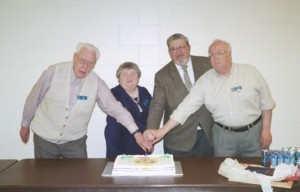 SARC Presidents Bill Cate VE3HR, Audrey Little VA3YD, Bob Chrysler VE3IEL, Gord Hogarth VE3CNA cut the cake at an anniversary party.